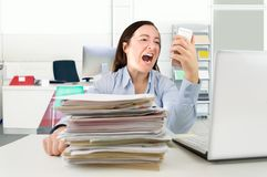 Woman screaming into phone receiver Royalty Free Stock Photos