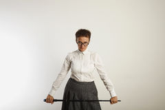 Angry female teacher with a pointer royalty free stock photography