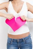 Angry female tearing paper heart apart Stock Photography