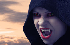 Angry female vampire at sunset. And moon Royalty Free Stock Image