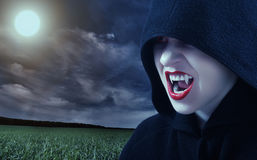 Angry female vampire at sunset. And moon Stock Image