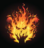 Angry fire. Angry face in a fire on the dark background Royalty Free Stock Photo