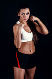 Angry fitness girl ready for fight on black background. Angry fitness girl ready for fight on black background royalty free stock photos