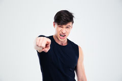 Angry fitness man pointing finger at camera Royalty Free Stock Image