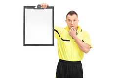 Angry football referee holding a clipboard Stock Photos