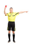 Angry football referee showing a red card Stock Image