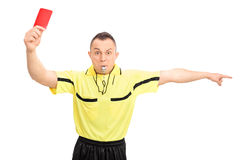 Angry football referee showing a red card Royalty Free Stock Image