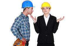 Angry foreman with helpless woman Stock Images