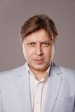 Angry Frowning Middle Age Man in Blue Jacket Stock Images