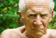 Angry Frowning Senior Man. Face portrait of an old angry frowning senior man royalty free stock photography