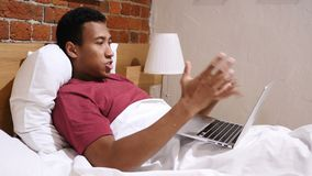 Angry Frustrated African Man Working Online at Night in Bed stock video