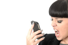 Angry Frustrated Annoyed Woman Shouting Into Cell Phone. Frustrated angry annoyed Woman with black hair and hispanic or european features, looking away from royalty free stock images