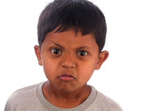 Angry, frustrated, irritated young boy(kid) isolated on white Royalty Free Stock Photography