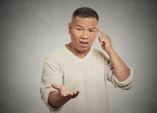 Angry frustrated man gesturing asking are you crazy? Stock Photo