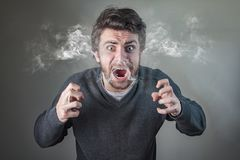 Furious man steaming with rage. Angry frustrated man yelling and steaming with rage, yelling loudly Royalty Free Stock Photos