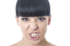 Angry Frustrated Stressed Young Woman With Attitude. With black hair and hispanic or european features, looking at camera Pulling a Face and gritting teeth stock images