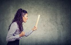 Angry woman with rolling pin screaming. Angry frustrated young woman with rolling pin screaming at someone Royalty Free Stock Photography