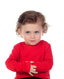 Angry funny baby with red t-shirt. Isolated on a white background Stock Photos
