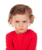 Angry funny baby with red t-shirt. Isolated on a white background Stock Photography