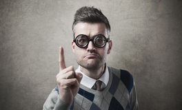 Angry funny guy reproaching somebody. Angry funny guy with glasses reproaching somebody and pointing Royalty Free Stock Photo