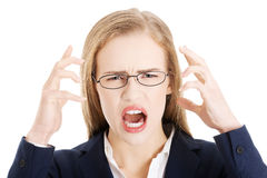 Angry and furious business woman with open mouth is screaming. Stock Image