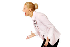 Angry and furious business woman screaming for someone Stock Photo