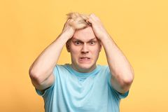 Angry furious man pulling his hair out royalty free stock photography