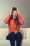 Angry furious outraged young woman girl. Headache. Royalty Free Stock Photography