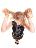 Angry furious woman pulling her messy hair Royalty Free Stock Photo