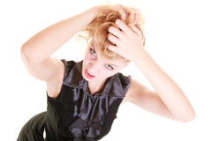 Angry furious woman pulling her messy hair Stock Images