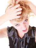Angry furious woman pulling her messy hair Stock Photo