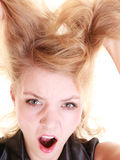 Angry furious woman screaming and pulling messy hair Royalty Free Stock Images