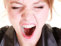 Angry furious woman screaming and pulling messy hair Stock Photos