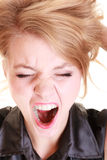 Angry furious woman screaming and pulling messy hair Stock Photo
