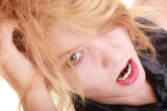 Angry furious woman screaming and pulling messy hair. Angry businesswoman crazy boss furious woman screaming and pulling messy hair isolated on white. Stress and Royalty Free Stock Photo
