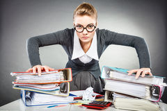Angry furious young blonde businesswoman. Royalty Free Stock Photography