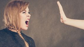 Angry furious young blonde woman. Facial emotions expression. Young blonde expressive angry furious yelling woman. Emotional girl full of anger and bad feelings Royalty Free Stock Photo
