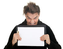 Angry, furious young man with clipboard Royalty Free Stock Photography