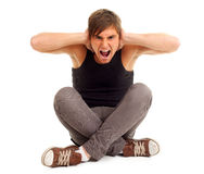 Angry, furious young man screaming Stock Photography