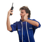 Angry, furious young man speaking on the phone Stock Image