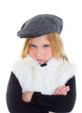 Angry gesture child sad blond kid girl portrait winter cap Royalty Free Stock Photography