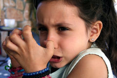 Angry Girl. With tears in her eyes Stock Image