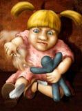Angry girl. Girl smashing the voodoo doll with sharp needle Stock Photos
