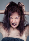 Angry girl with black lips Royalty Free Stock Image