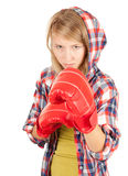 Angry girl in boxing gloves Royalty Free Stock Photography