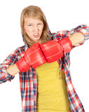 Angry girl in boxing gloves Royalty Free Stock Image