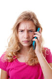 Angry Girl is calling on mobile phone Stock Photo