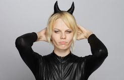 Angry girl with devil costume Royalty Free Stock Images