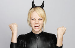 Angry girl with devil costume Royalty Free Stock Photography
