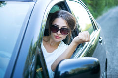 Angry girl driver looks out of the car window Royalty Free Stock Images